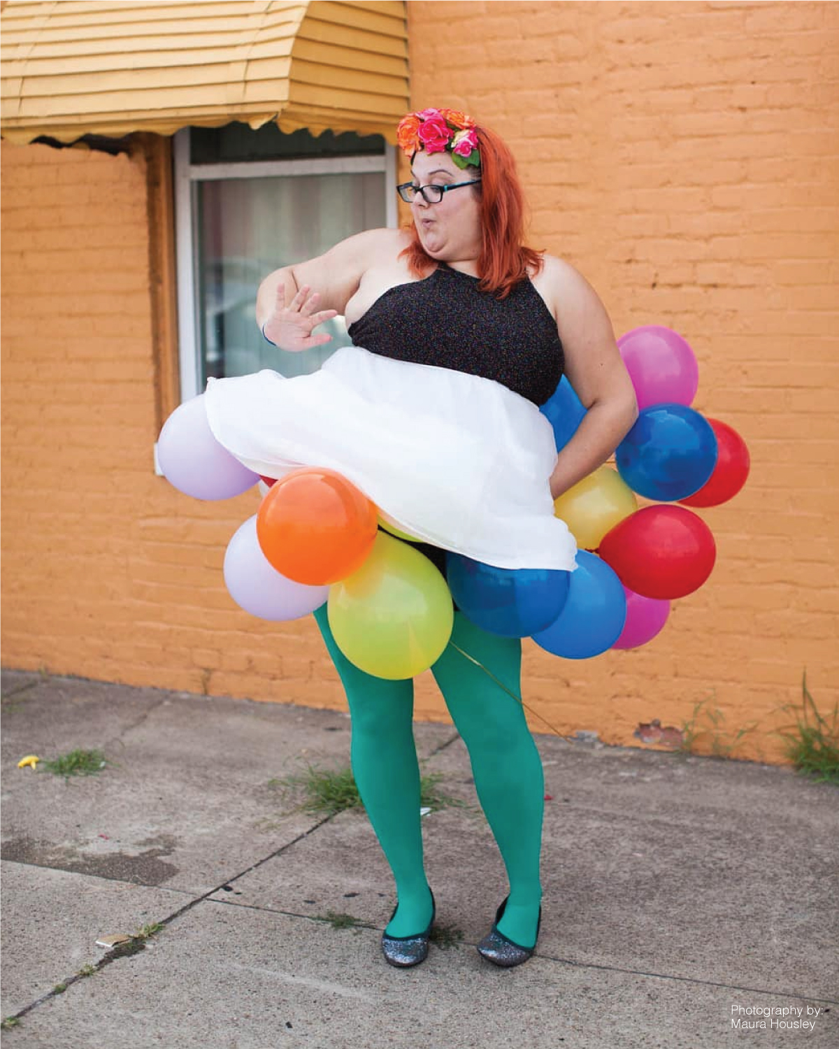 plus size woman standing on the street wearing a balloon skirt and green tights