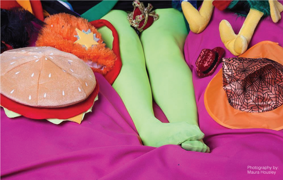 women sitting on a bed wearing mint green tights surrounded by stuffed animals