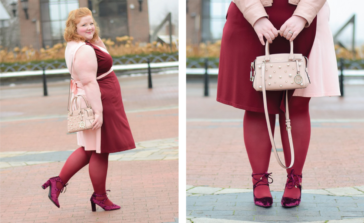 plus size woman blogger walking down the streets wearing a monochromatic maroon outfit