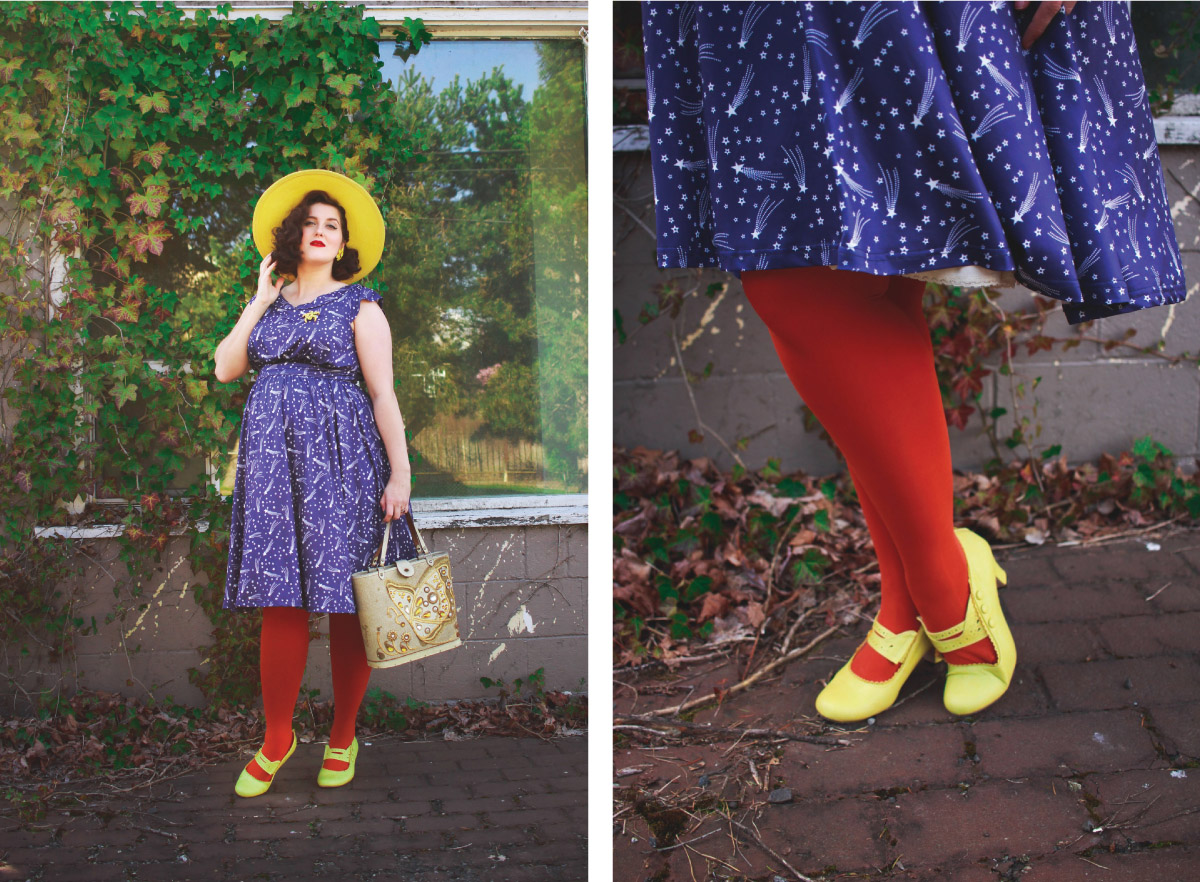 woman model standing against a window with plants wearing blue dress red tights