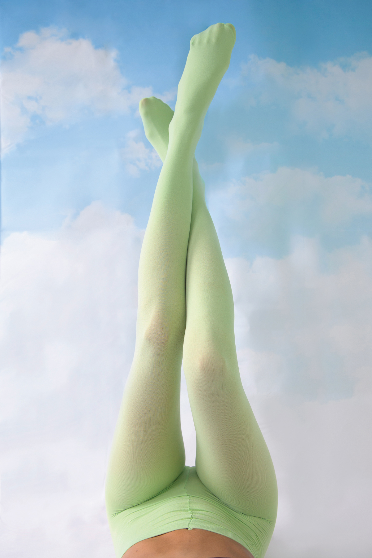 Legs with tights floating with a sky background