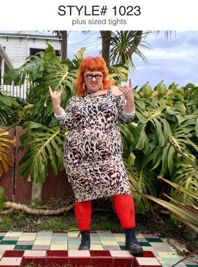 happy fierce plus size redhead woman wearing glasses leopard print dress red tights lace up boots