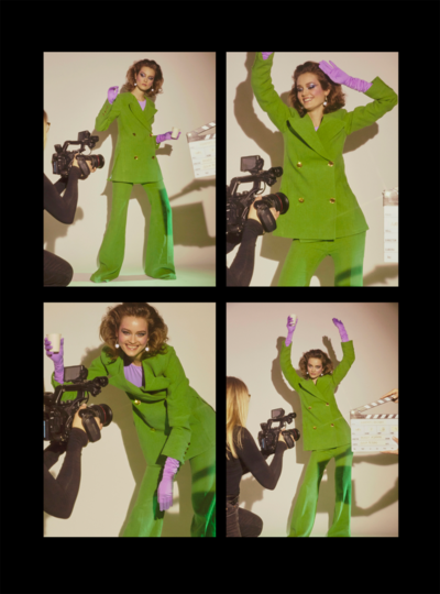 woman wearing green outfit wearing lilac shoulder gloves
