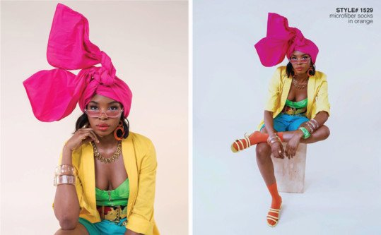 Model sitting in a chair in a white background wearing colored clothing and head wrap